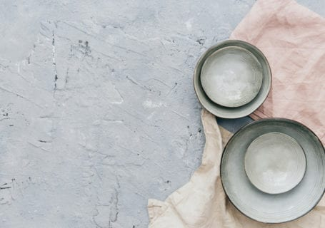 Ceramic bowls on a textured background