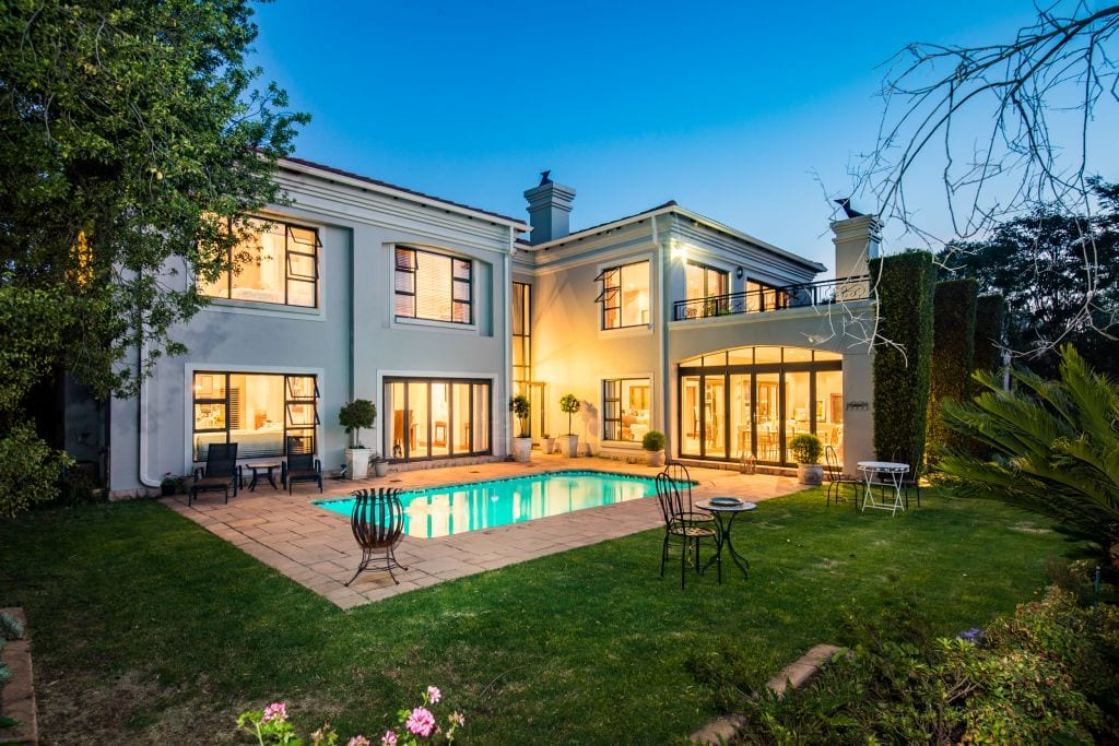 Priced at R8.995 million, this grand mansion offers six bedrooms, four garages, a built-in bar and basement wine cellar, a games room and study.